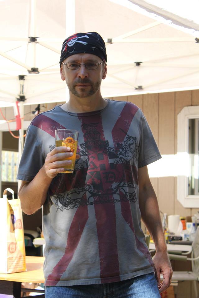 Kevin tasting home fermented cider